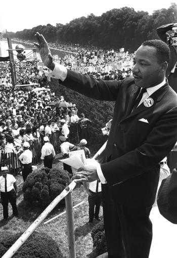 Martin Luther King Jr. waves to supporters Aug. 28, 1963, from the Lincoln Memorial from where he delivered his 'I Have a Dream' speech.
