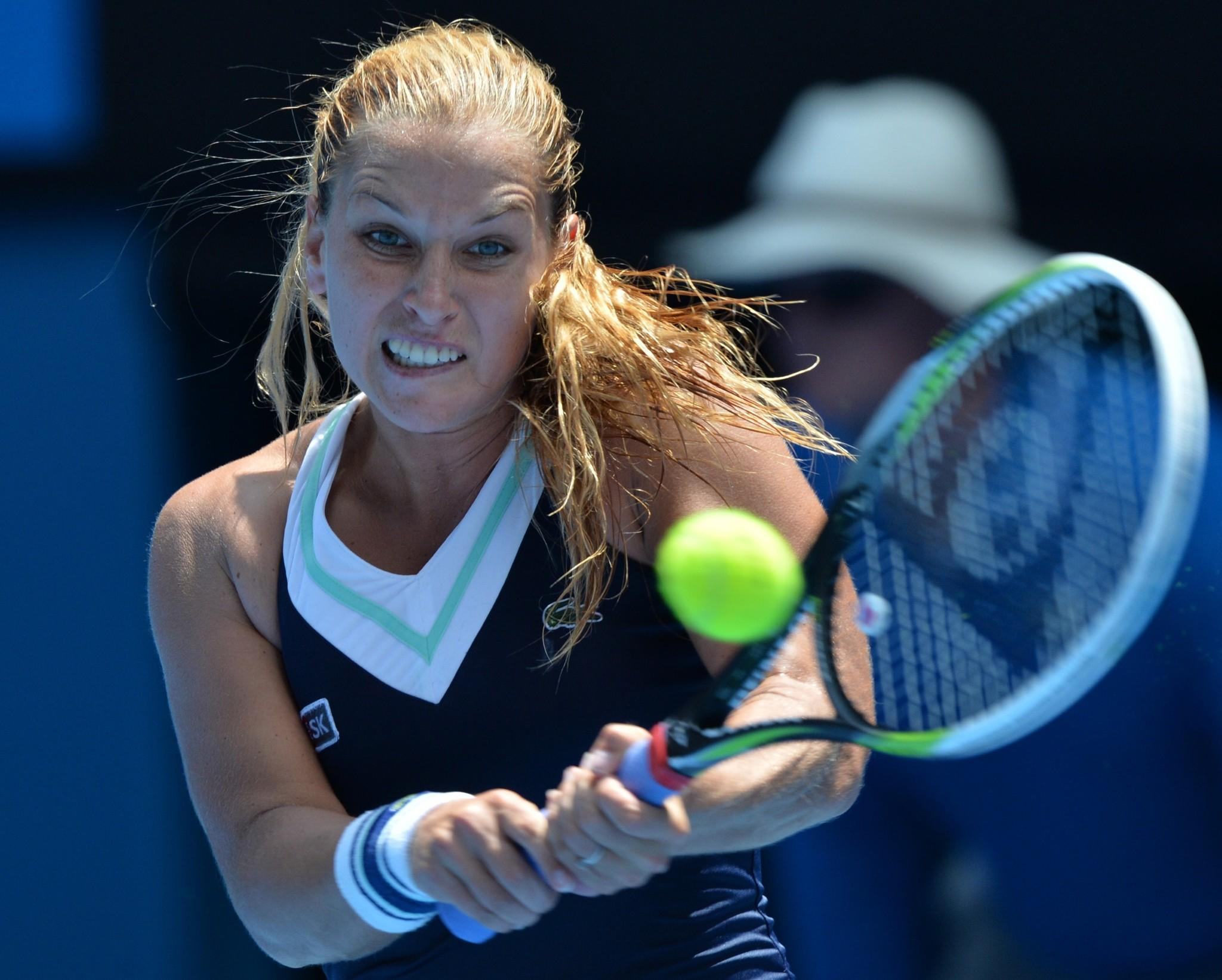 Slovakia's Dominika Cibulkova plays a shot during her women's singles match against Russia's Maria Sharapova.
