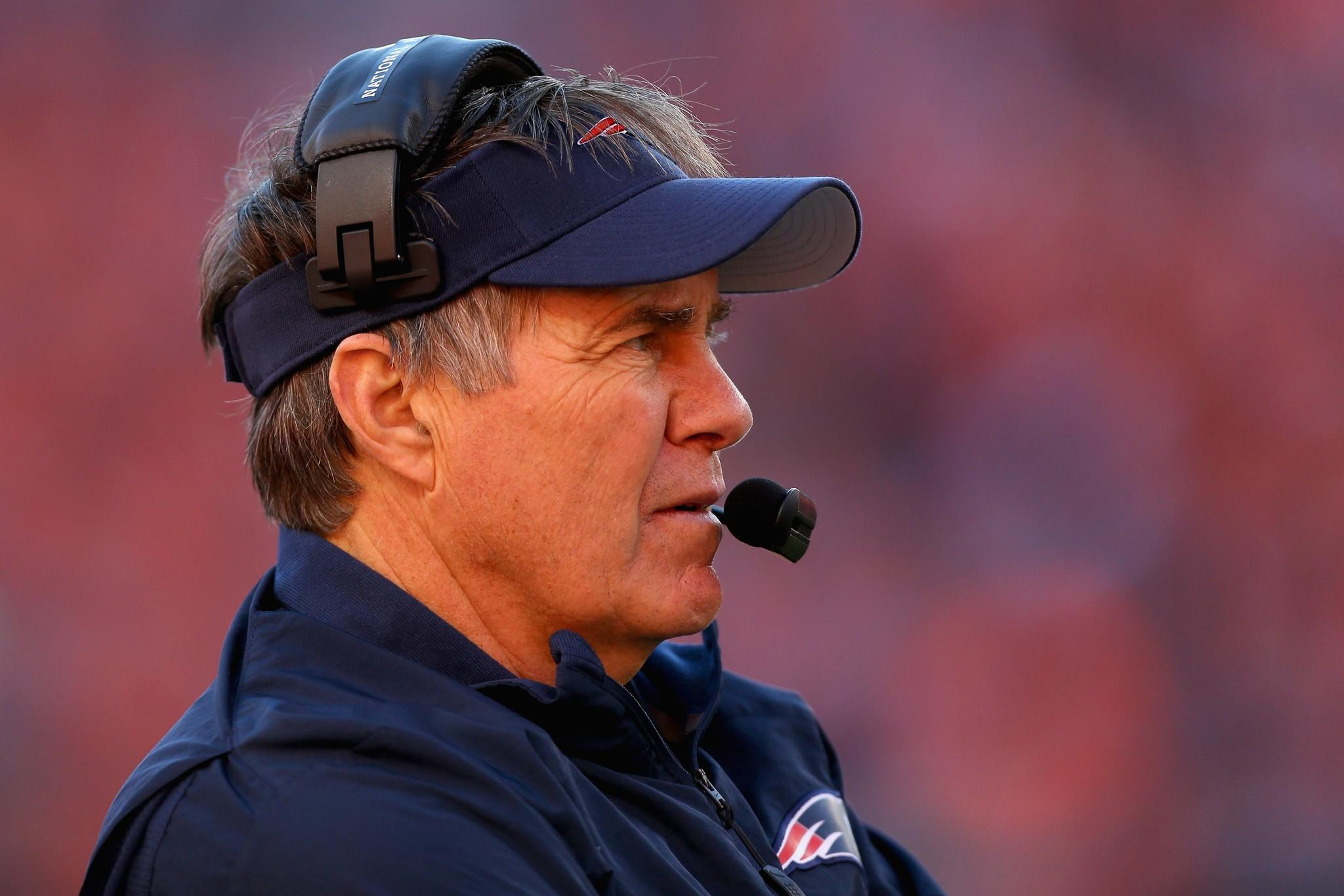 Head coach Bill Belichick of the New England Patriots looks on against the Denver Broncos during the AFC Championship game.