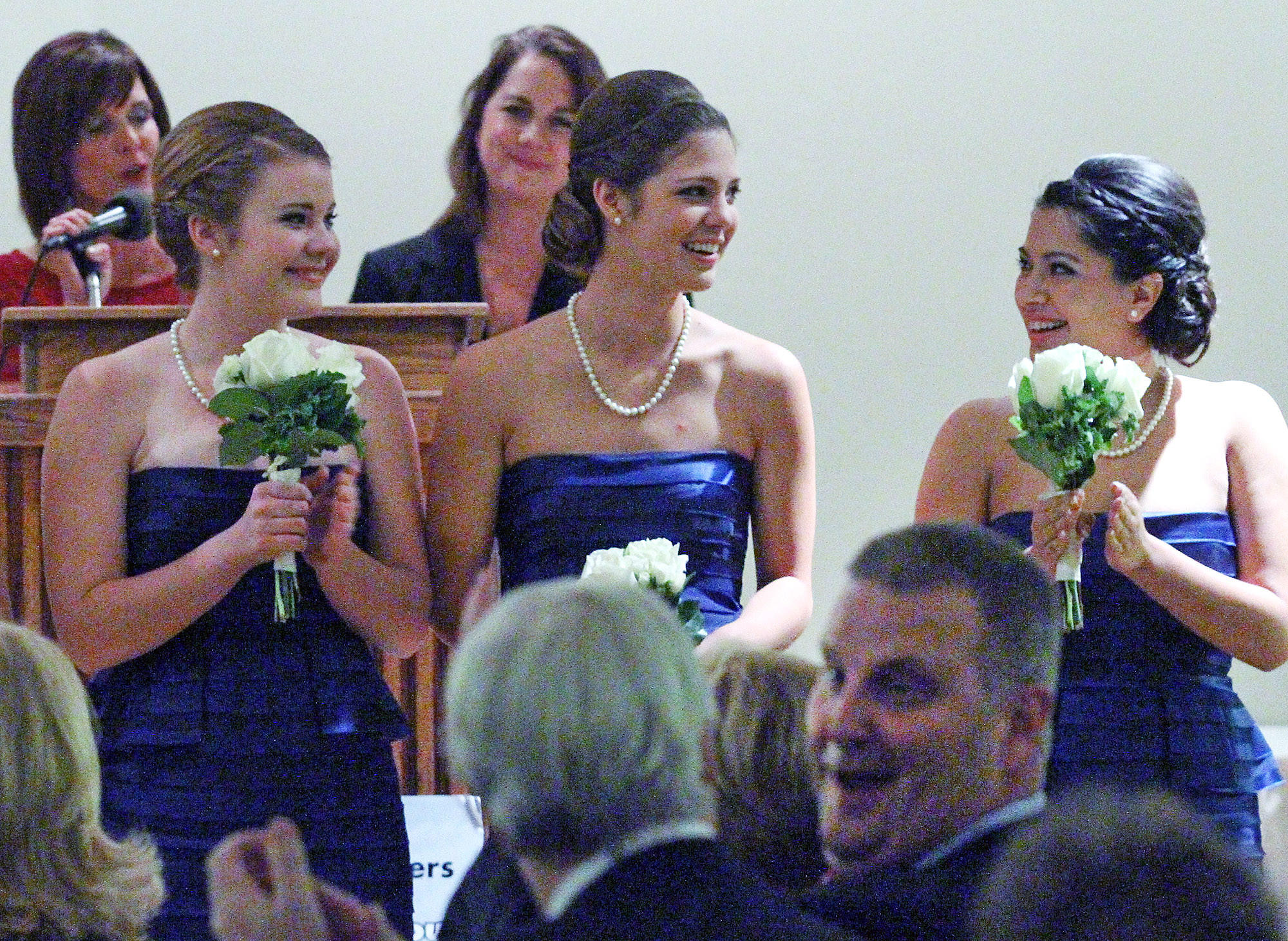 Kaitlin Powers, center, is applauded by Caroline Kenney and Sabine Puglia after she is named Miss La Cañada Flintridge 2014 at the 102nd Installation and Awards Gala for the La Cañada Flintridge Chamber of Commerce and Community Association at the La Cañada Flintridge Country Club on Thursday, January 16, 2014. The Announcement and Coronation of Miss La Cañada Flintridge 2014 and Her Royal Court also took place.