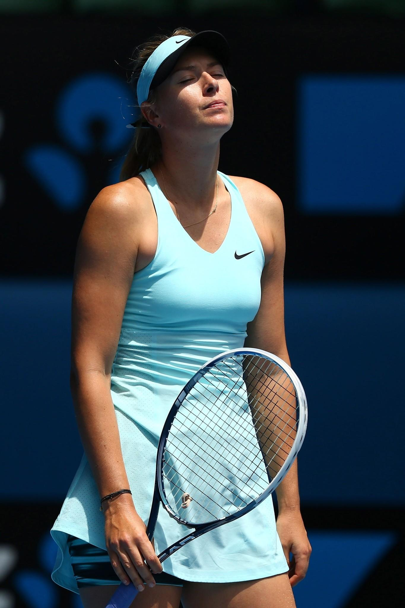 Maria Sharapova of Russia reacts to a point in her fourth round match against Dominika Cibulkova of Slovakia during day eight of the 2014 Australian Open at Melbourne Park on January 20, 2014 in Melbourne, Australia.