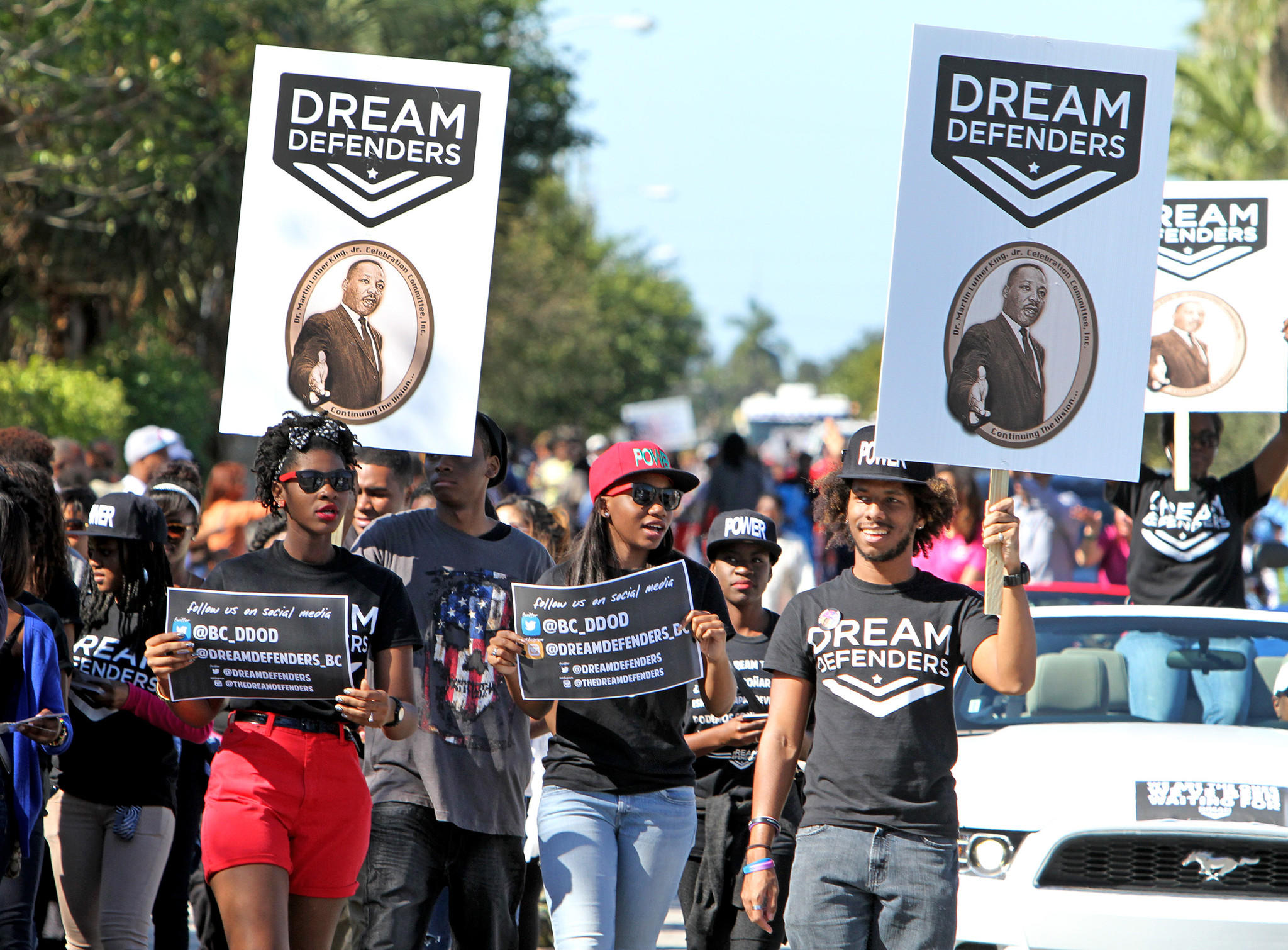 Members of the Dream Defenders, a social action student organization, marches down Sistrunk Blvd. during the Dr. Martin Luther King Parade. The holiday parade featured local marching bands, drum lines and marchers representing local social, civic, cultural and religious organizations.
