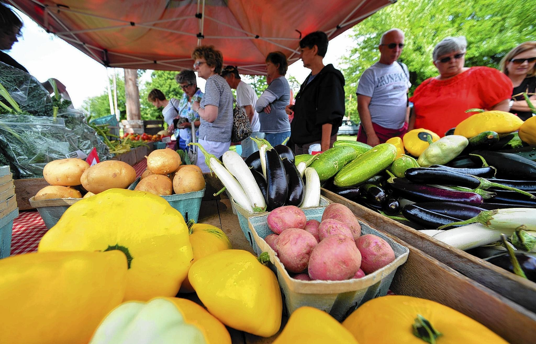 Buying food at local farmers markets, such as this one in Macungie, contributes to the local economy.