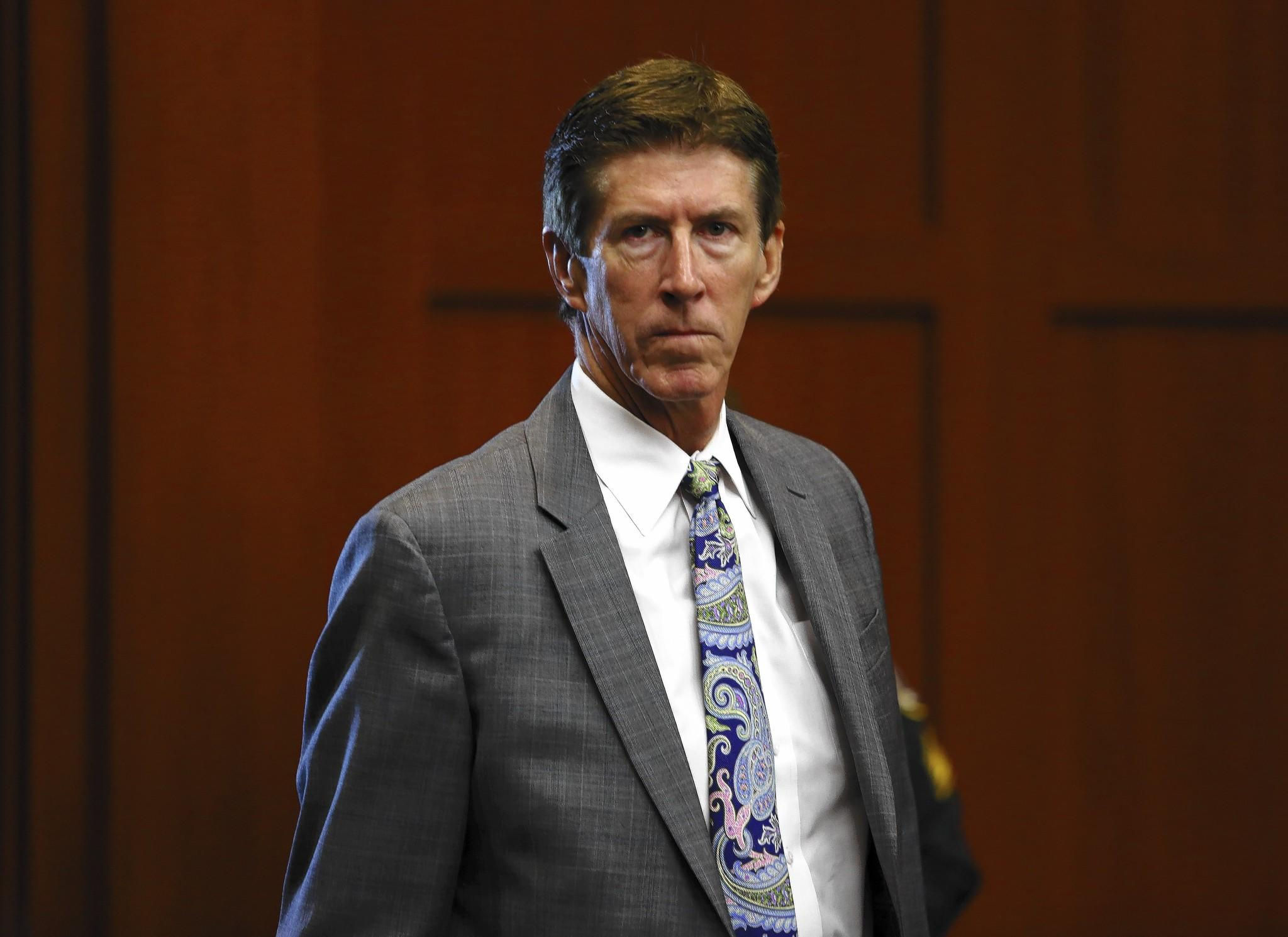Defense attorney Mark O'Mara enters the courtroom at George Zimmerman's trial in June.