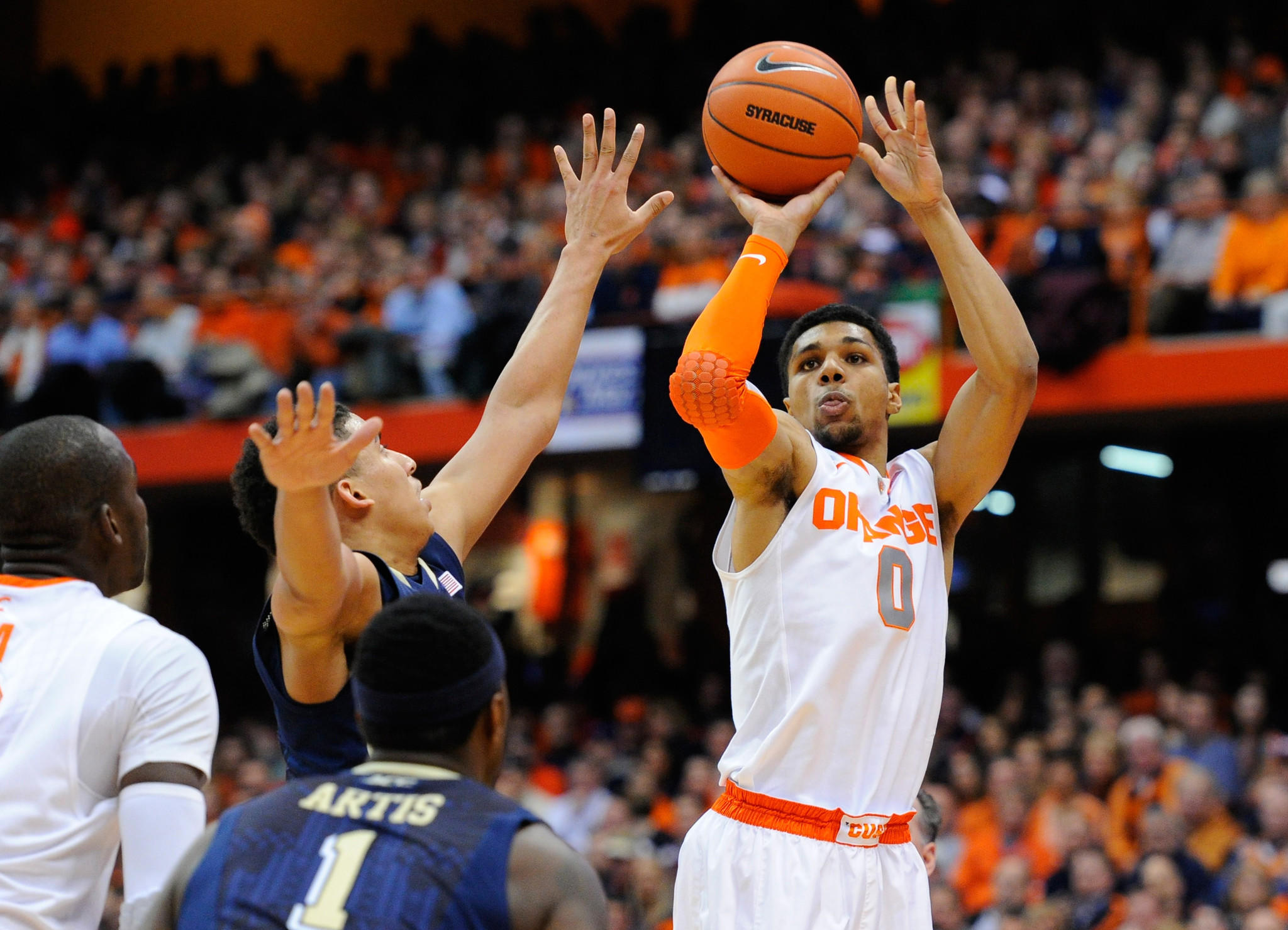 Syracuse Orange forward Michael Gbinije (0) takes a shot around Pittsburgh Panthers guard James Robinson (left) during the first half at the Carrier Dome. Syracuse defeated Pittsburgh 59-54.