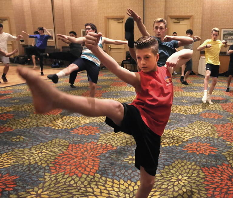 """Dylan Amsterdam, 14, of Delray Beach practices with fellow dancers at auditions for """"Newsies"""" in Orlando."""