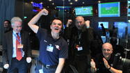 'Hello, world': Rosetta spacecraft wakes for comet-chasing mission