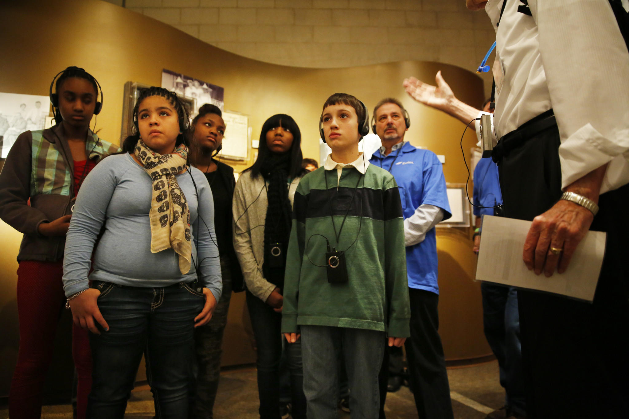 "Chicago and Cicero public school students listen Monday during a tour of the Illinois Holocaust Museum and Education Center in Skokie, presented by docent Chuck Kramer, right, as part of a corporate-sponsored ""Stay in School Initiative"" on the Rev. Dr. Martin Luther King, Jr. holiday."
