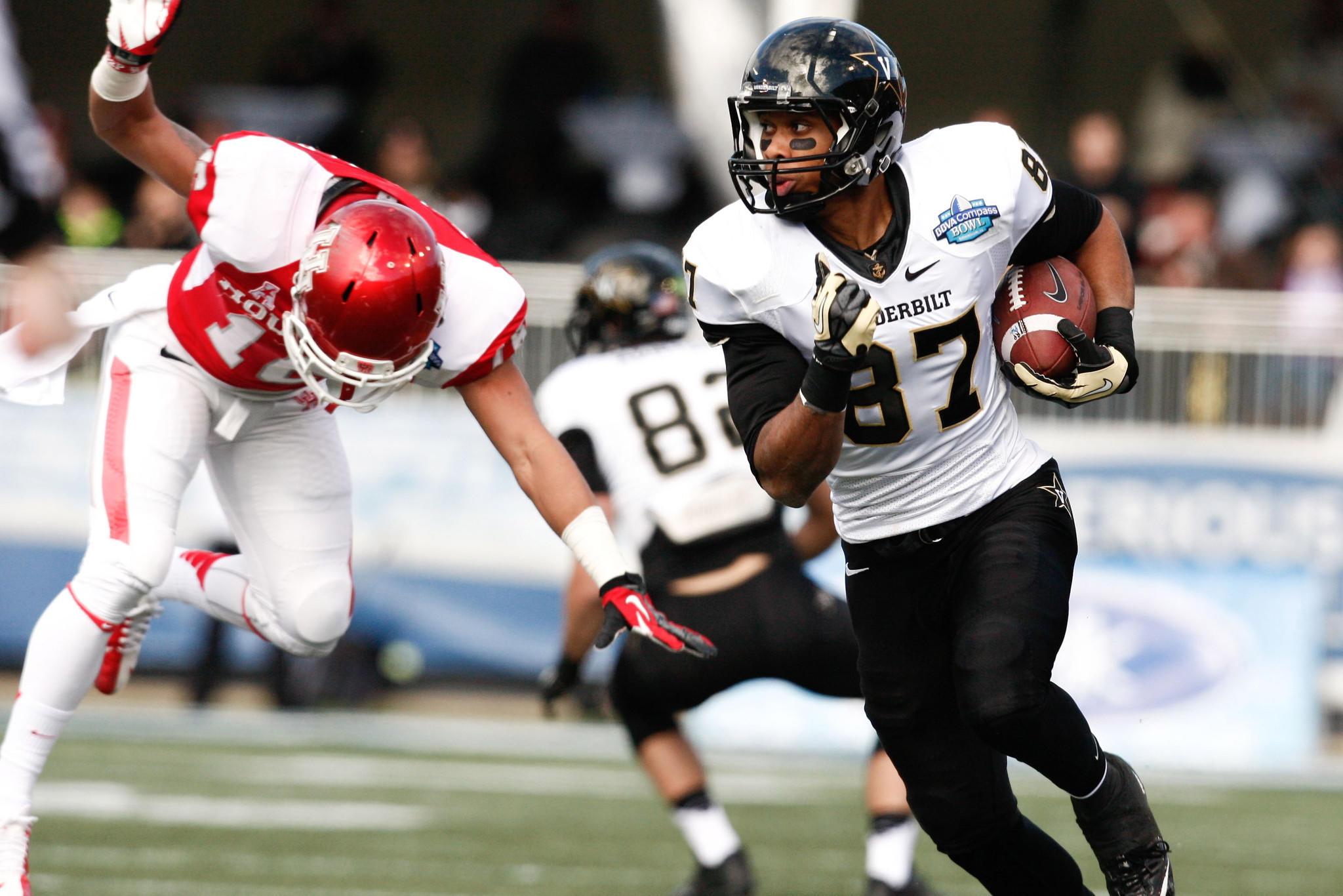 Vanderbilt wide receiver Jordan Matthews sprints toward a touchdown in the 2014 Compass Bowl against Houston.