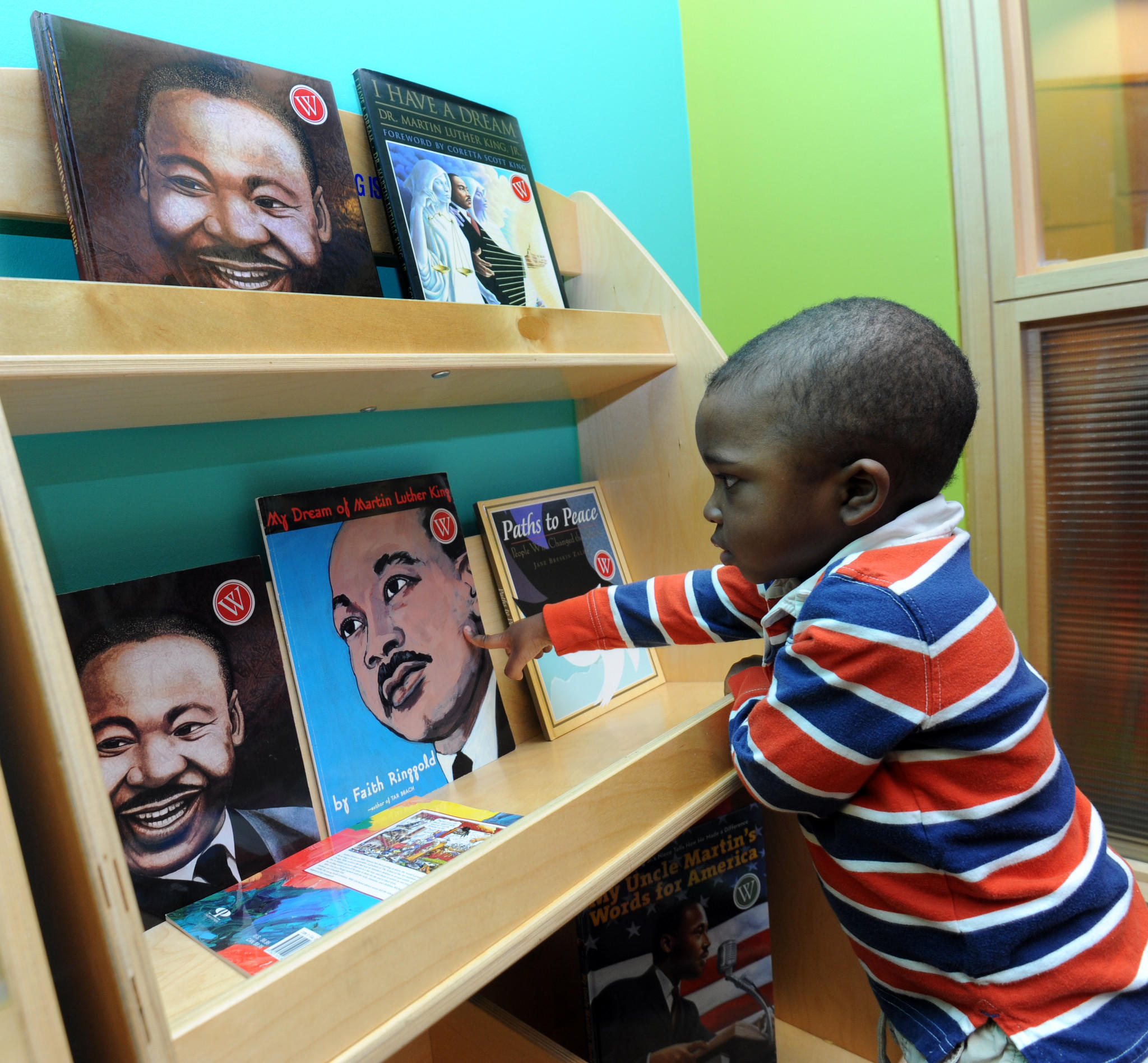 Emanuel Francis, 2, looks at books on Martin Luther King, Jr. He came to the museum with his mother, Lucine Francis from Baltimore. A free Martin Luther King, Jr. family festival was held at the Walters Art Museum which included art activities for children.