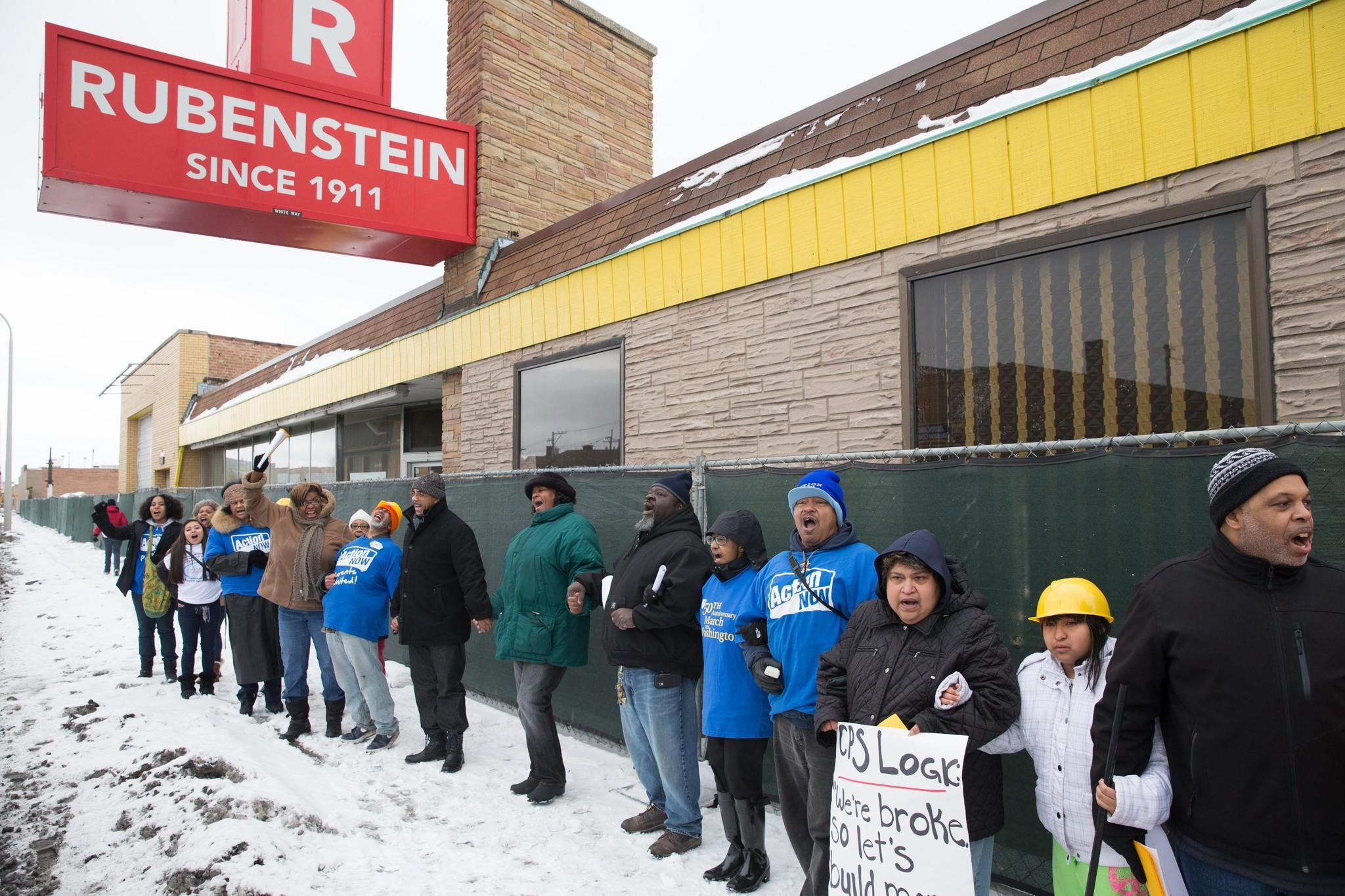 Community groups gather for a protest outside the proposed site for a new charter school in the Austin community of Chicago on Monday. An existing high school is across the street and the groups believe any money available for schools should support existing ones.