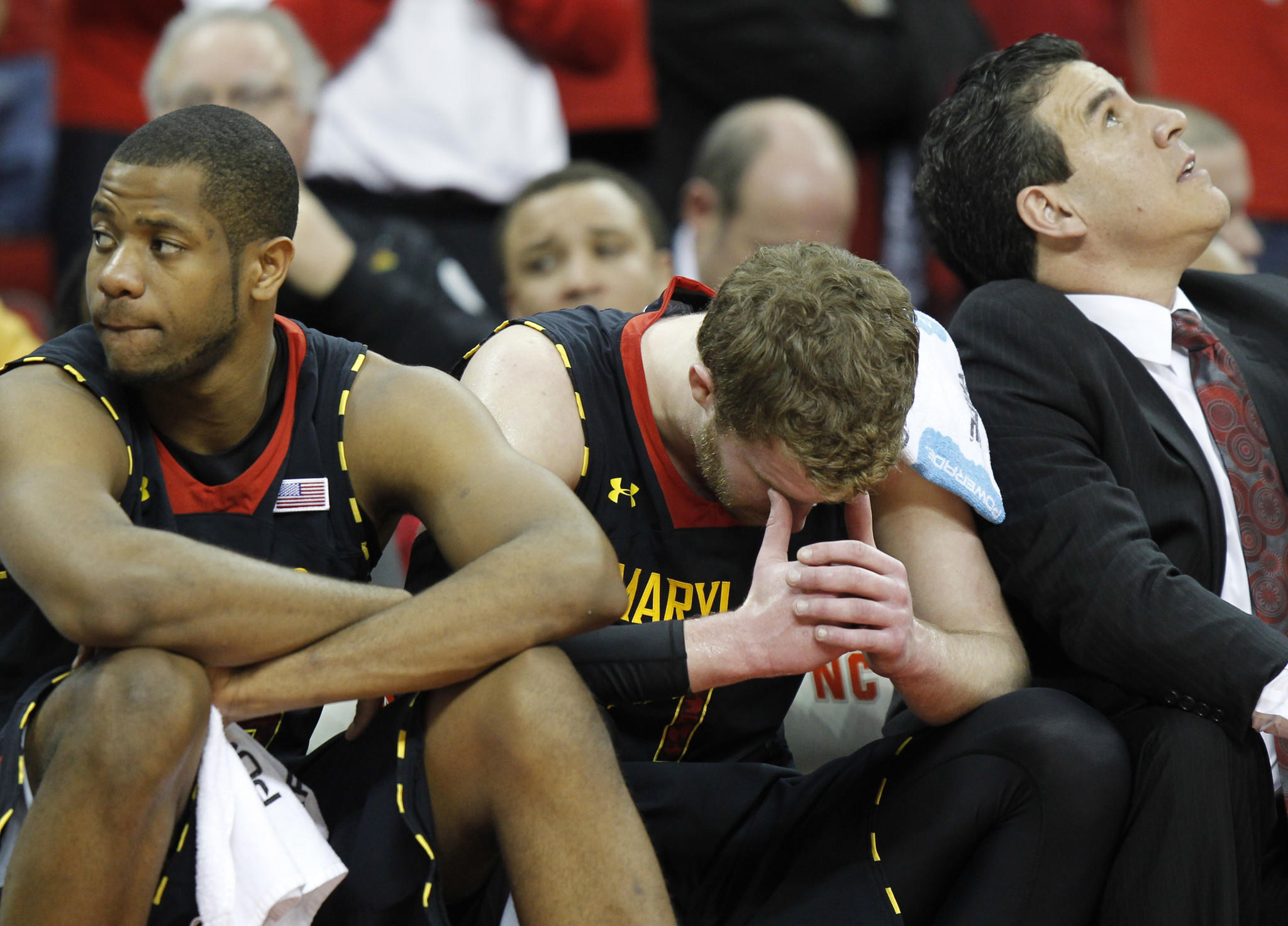 Maryland forward Damonte Dodd (left) and forward Evan Smotrycz (center)react during the game against North Carolina State.