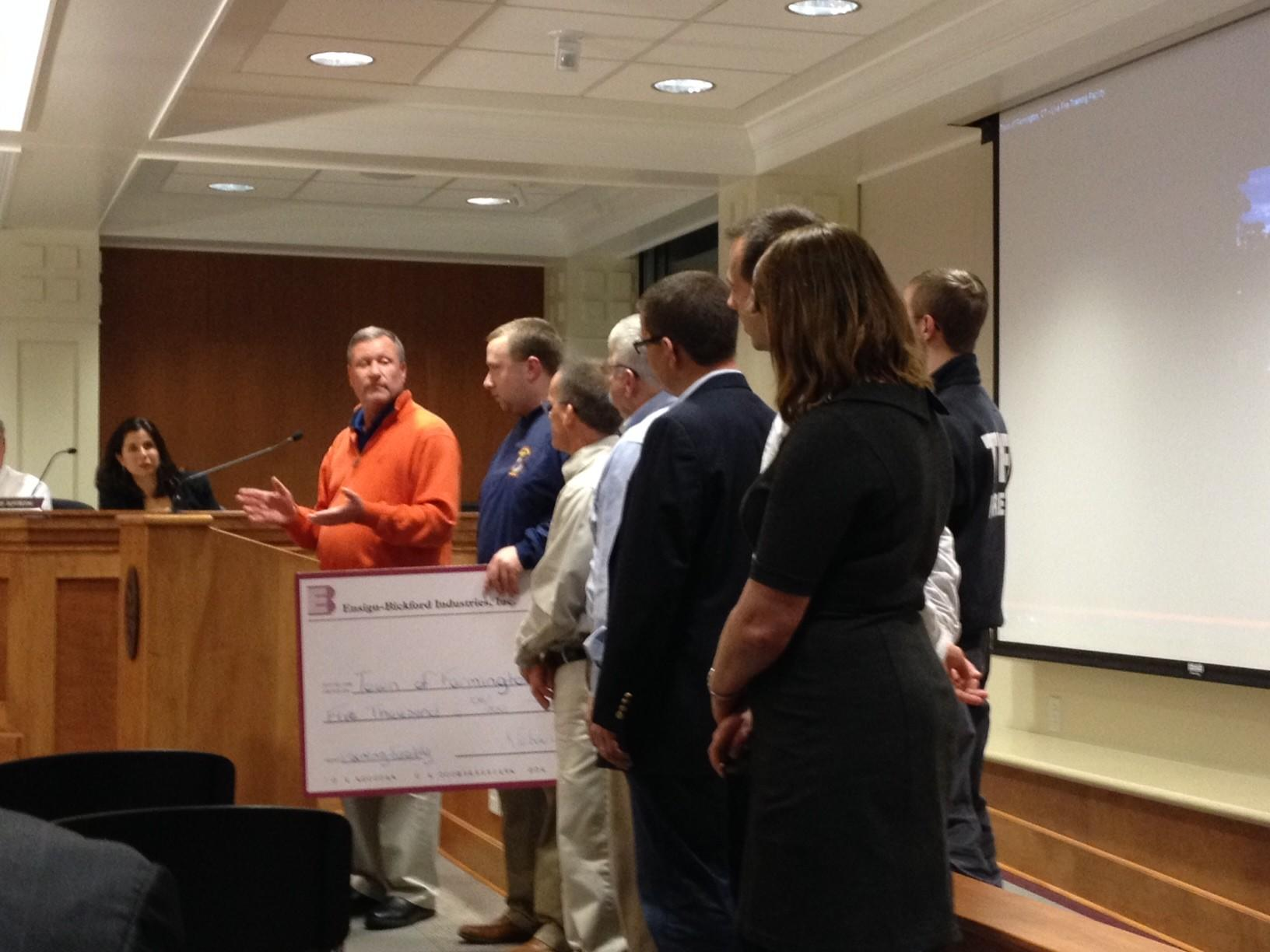 The fire department at a recent town council meeting received a check for $5,000 from the Ensign-Bickford Foundation for a live fire training facility.