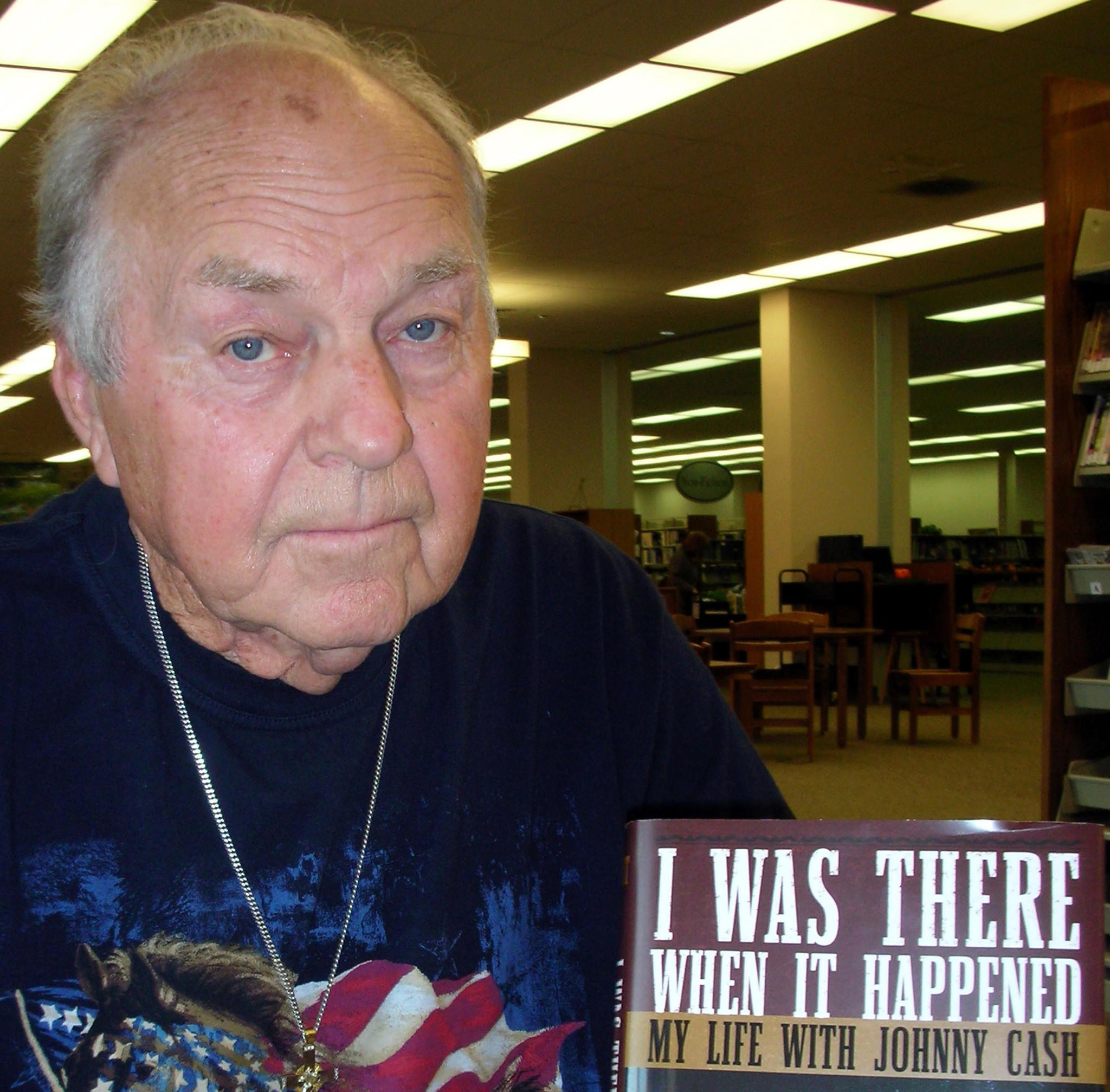 """Marshall Grant poses with a copy of his book, """"I Was There When It Happened: My Life with Johnny Cash,"""" in 2007."""