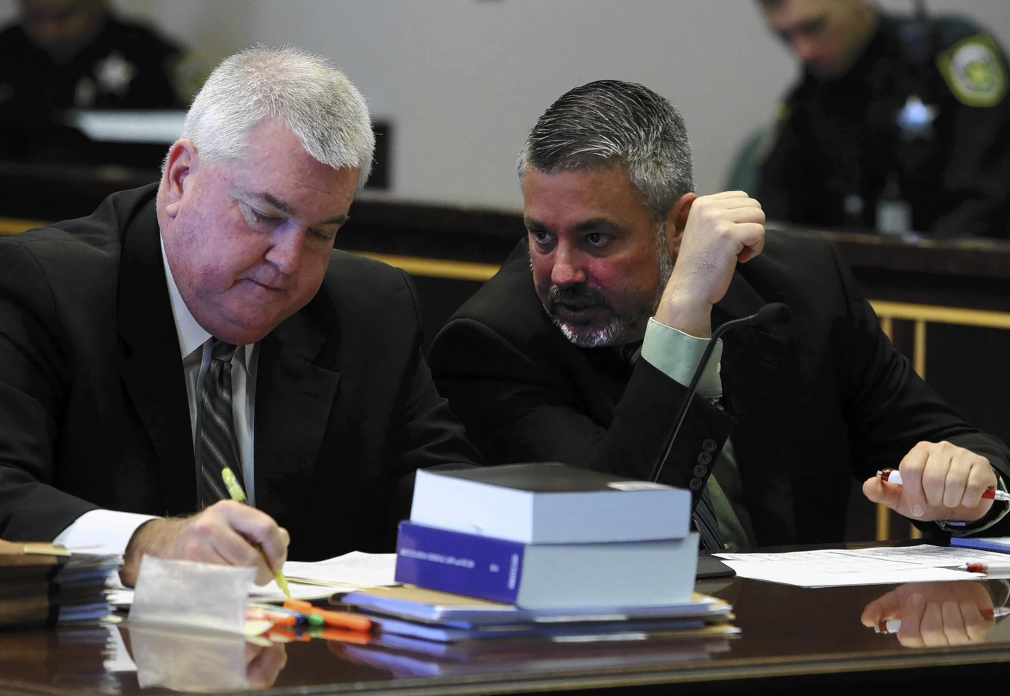 Former Windermere police chief Daniel Saylor talks with his defense attorney William McClellan. Jan. 21, 2014 B583477850Z.1 George Skene/Orlando Sentinel