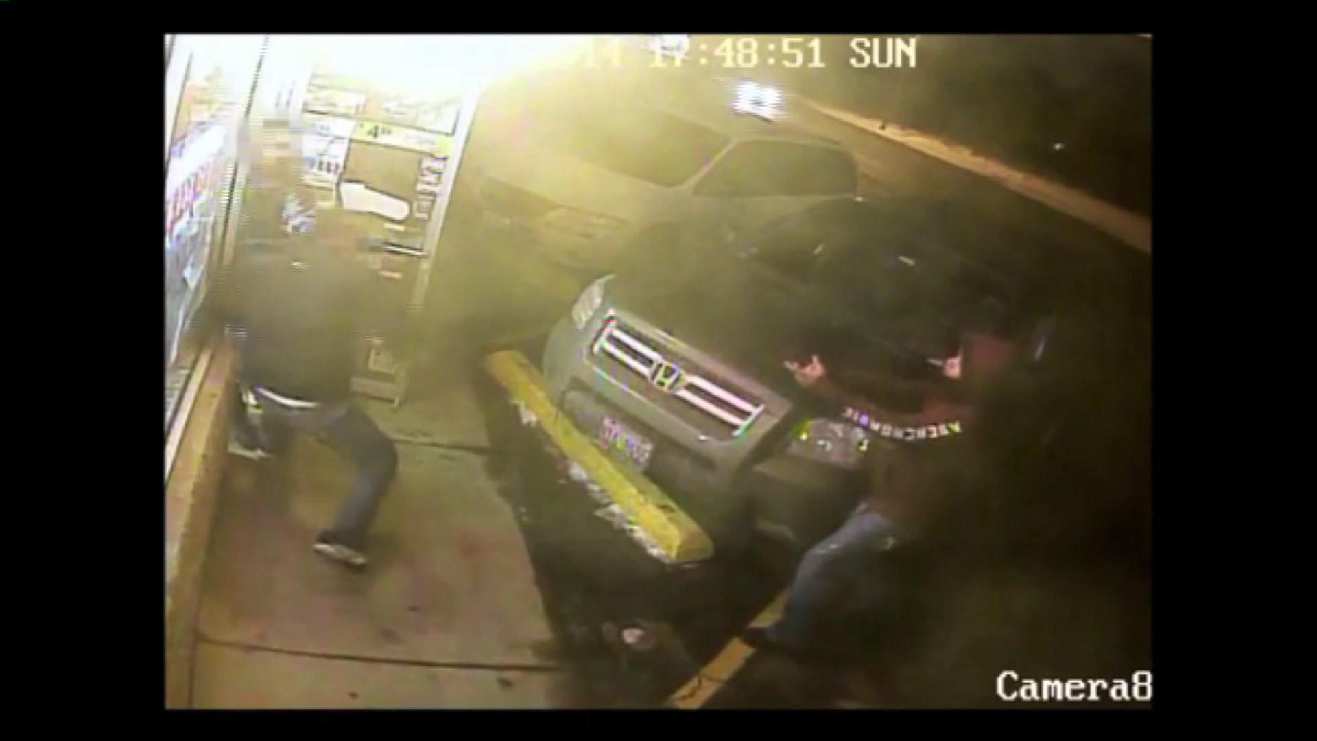 This surveillance video of the Bensenville convenience store robbery wehre a 36-year-old clerk was shot and killed.