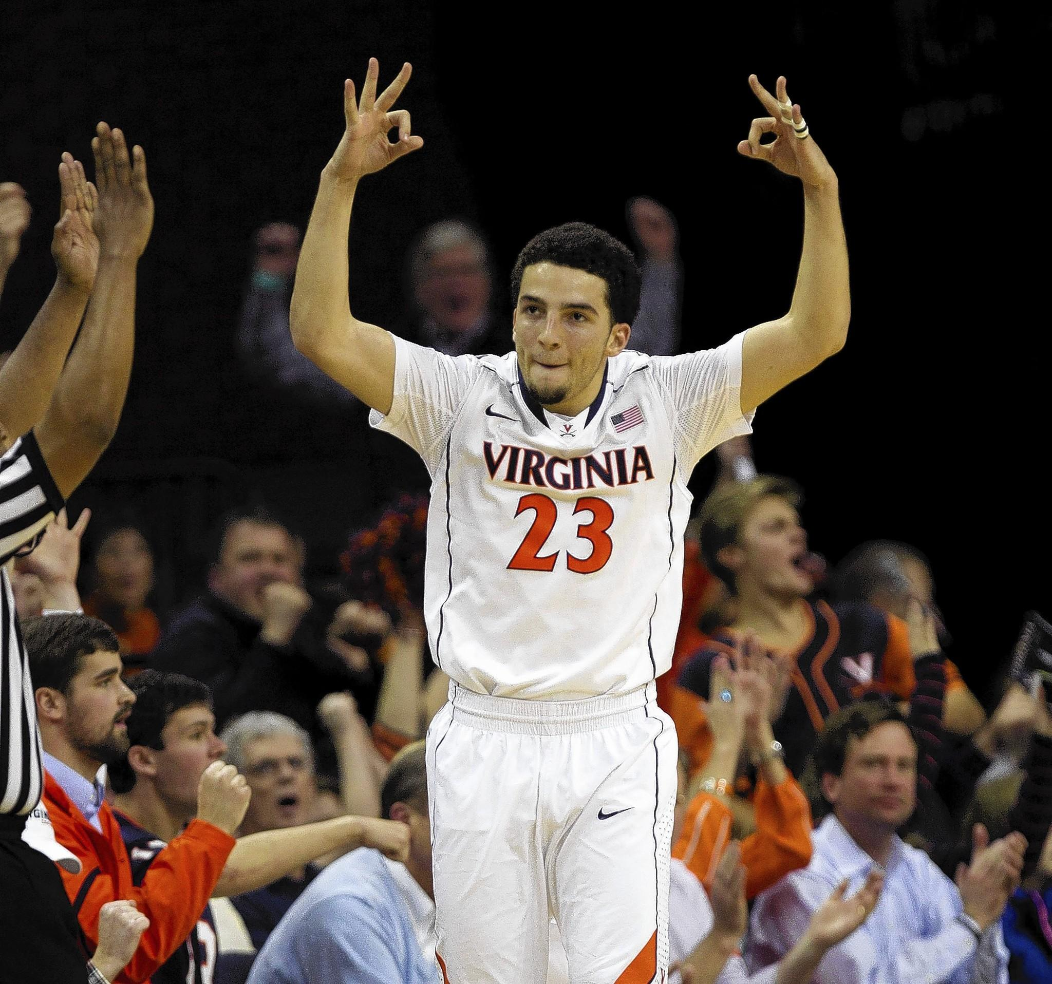 Virginia Cavaliers' London Perrantes (23) celebrates after sinking a 3-pointer against North Carolina in the first half at John Paul Jones Arena in Charlottesville, Va., on Monday, Jan. 20, 2014. Virginia rolled to a 76-61 victory over North Carolina.