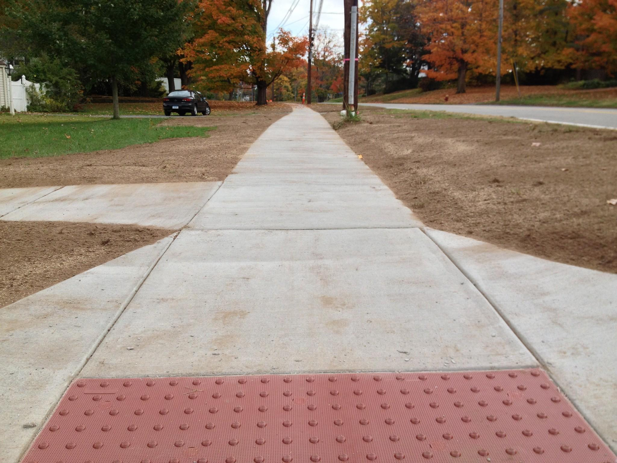 The town council agreed to spend $40,000 set aside by a developer for a ribbon of new sidewalks along Route 83 or Manchester Road near the intersection with Hebron Avenue.