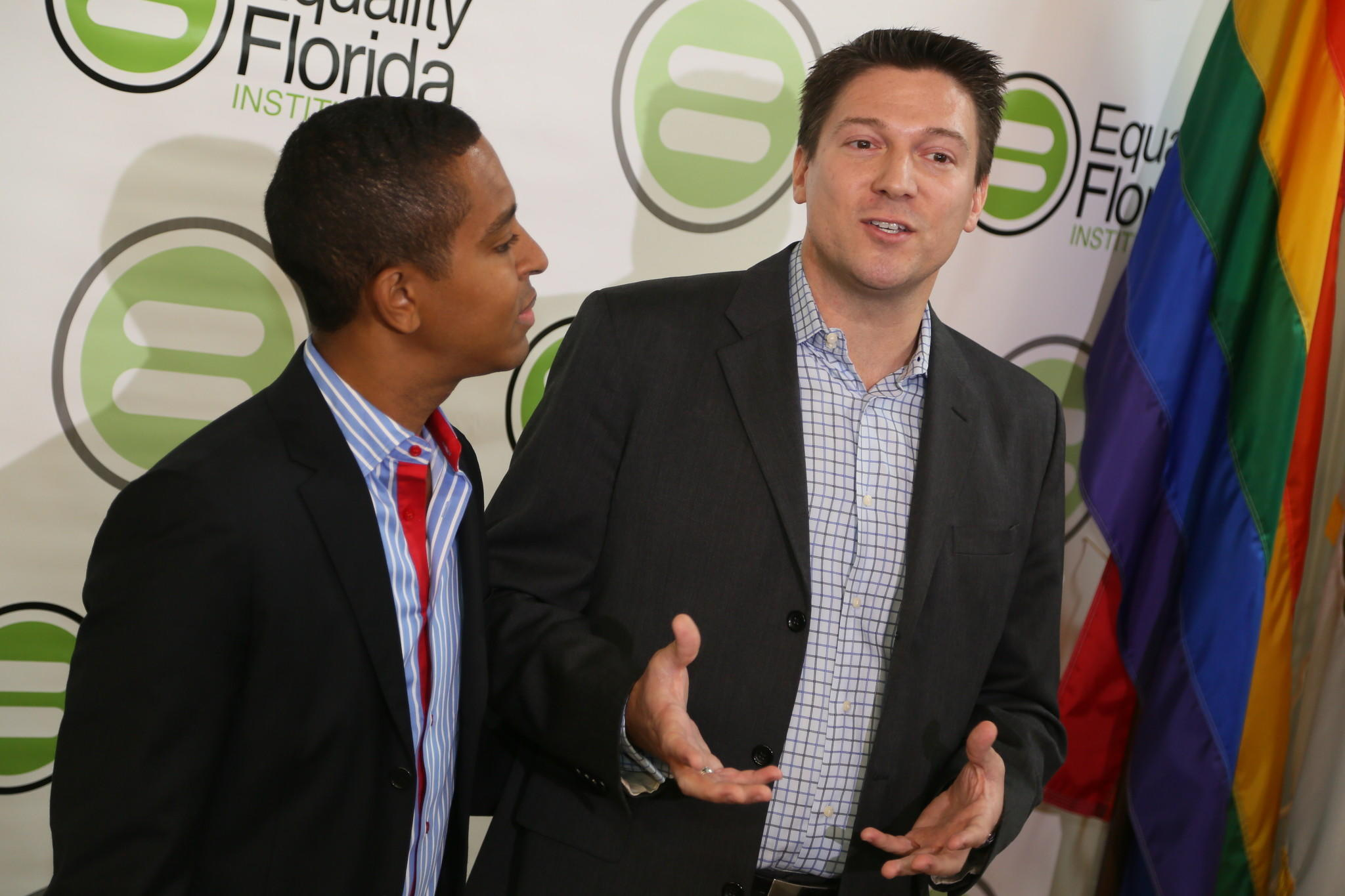 Jeff Delmay looks on as his partner, Todd Delmay, both of Hollywood, speaks during a news conference held by Equality Florida in Miami Beach on Tuesday, Jan. 21, 2014. Six gay couples, including four couples from Broward County, are the plaintiffs in a lawsuit filed Tuesday by the main statewide gay rights group, Equality Florida. Amy Beth Bennett, Sun Sentinel