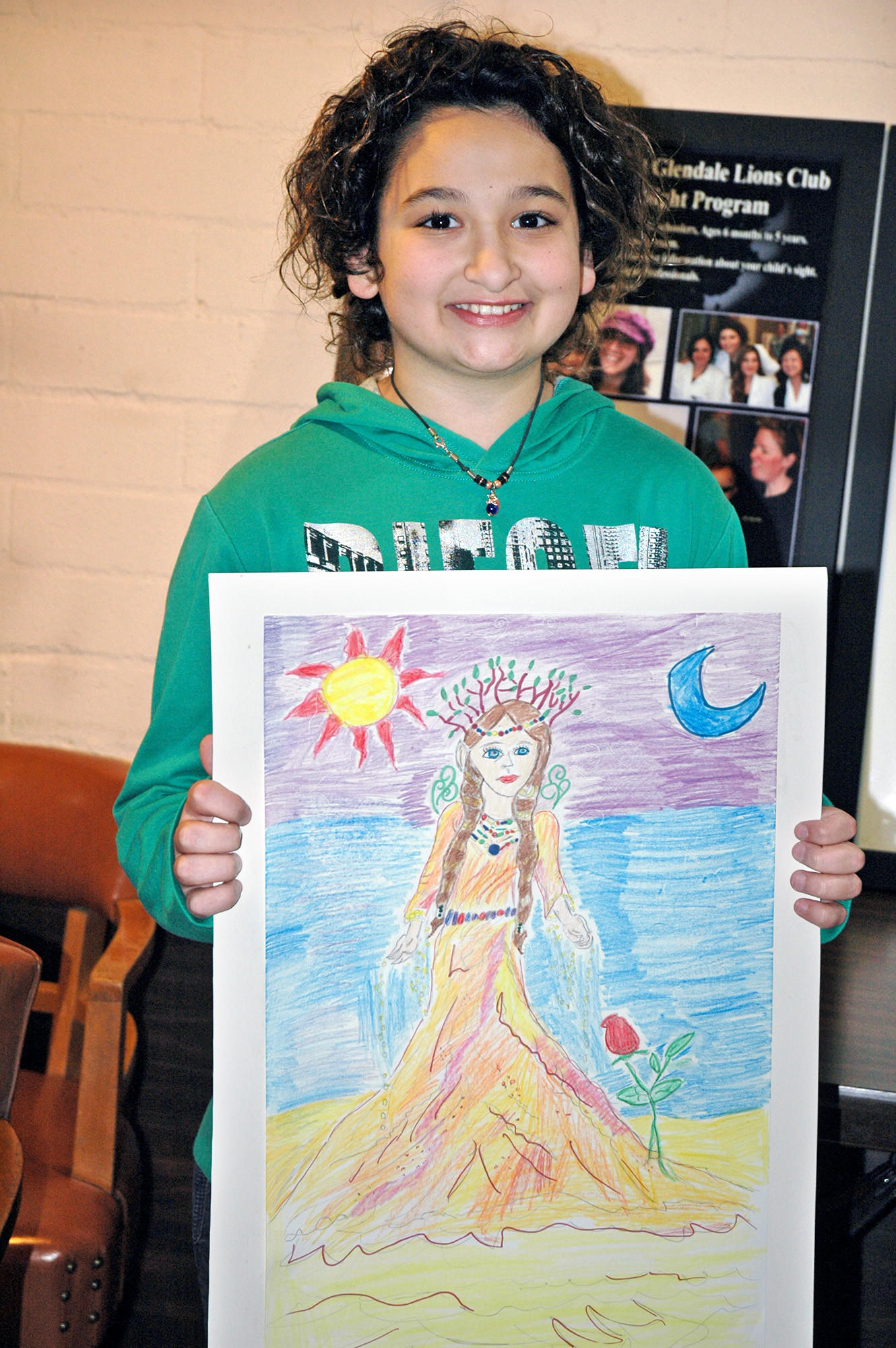 "The Northwest Lions Club presented a $50 check to its Peace Poster contest winner David Ramazyan at a luncheon meeting in December. The Columbus Elementary School fifth-grader titled his poster ""Mother Nature""."