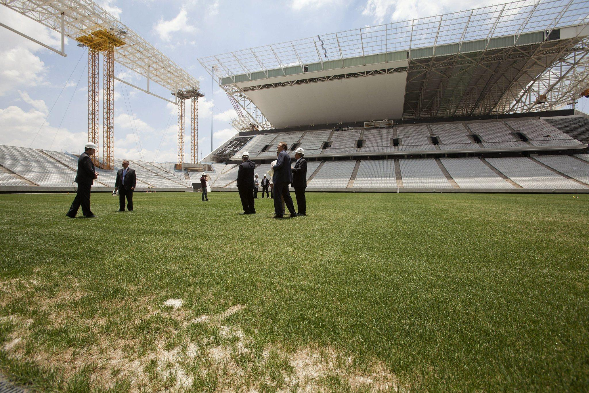 FIFA general secretary, Jerome Valcke (2-R), next to members of organizing committee for World Cup, visits the Arena Corinthians stadium, which is under construction for the FIFA World Cup Brazil 2014, in Sao Paulo.