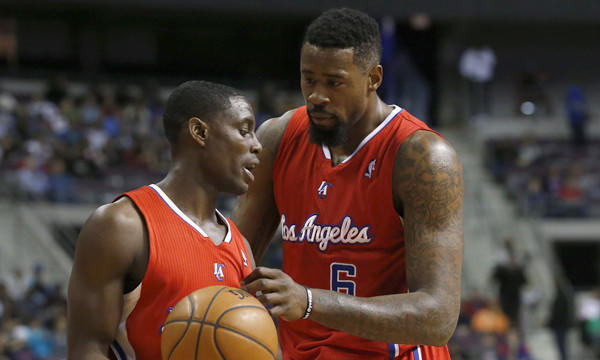 Clippers point guard Darren Collison, left, and center DeAndre Jordan talk during Monday's win over the Detroit Pistons.