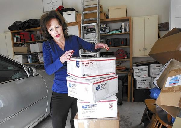 Mary Ellen Cartetr, founder of the nonprofit Direct Connections to Africa, prepares boxes of school supplies to send to Malawi from her Laguna Beach home.