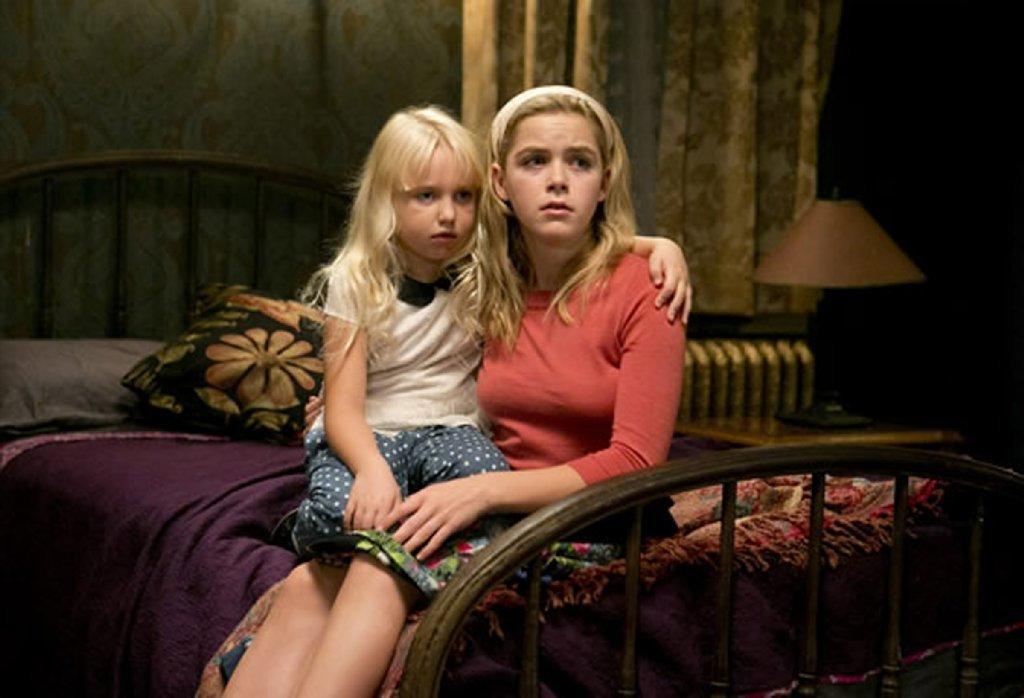 "Ava Telek and Kiernan Shipka appear in a scene from the Lifetime movie ""Flowers in the Attic."""