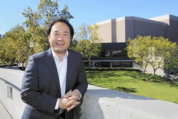 "Maestro Daniel Suk poses for a portrait in front of the Irvine Barclay Theatre on Friday. Suk will conduct Dvorak's Symphony No. 9 ""From the New World"" during Dream Orchestra's 2014 concert at the Irvine Barclay Theatre on Jan. 25."