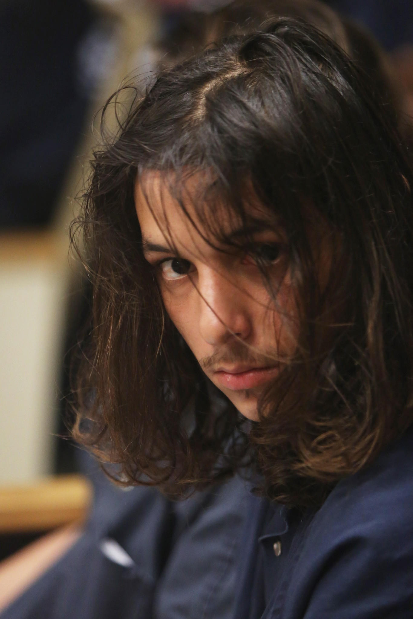 Christopher Rodriguez, 19, waits for his first appearance on charges of first-degree premeditated murder at the the John E. Polk Correctional Facility in Seminole county, on Tuesday, January 21, 2014.