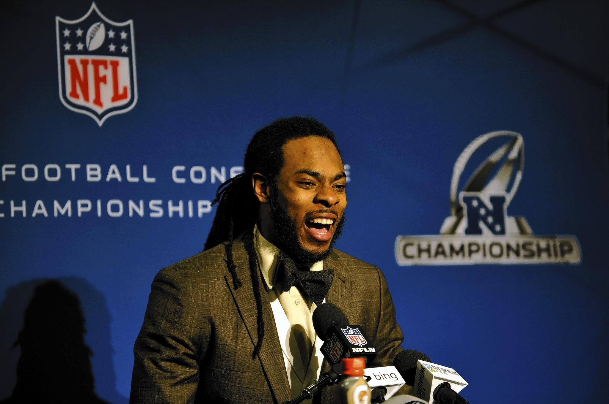 Jan 19, 2014; Seattle, WA, USA; Seattle Seahawks cornerback Richard Sherman (25) addresses the media after the 2013 NFC Championship football game against the San Francisco 49ers at CenturyLink Field.