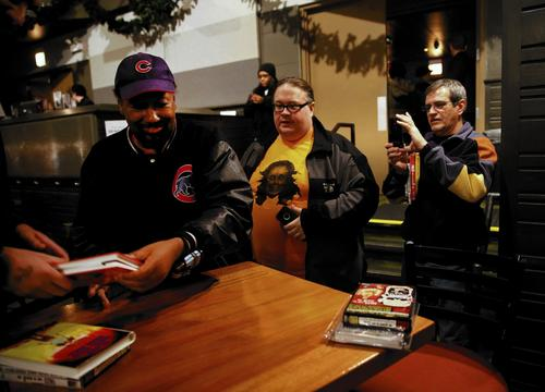 Film director Chester Novell Turner signs copies of his movies for fans following a screening of his 1987 film Tales from the Quadead Zone at Lincoln Hall.