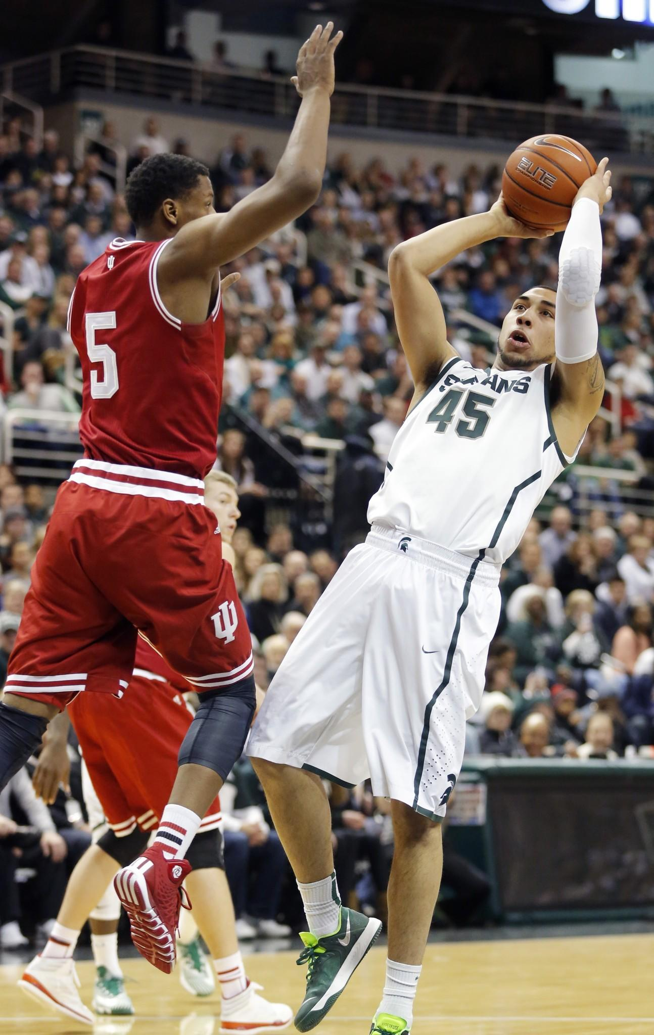 Michigan State's Denzel Valentine takes a shot against Indiana's Troy Williams during the first half at Breslin Center.