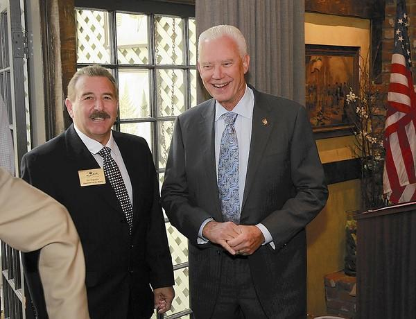Newport Beach Mayor Rush Hill, right, arrives and says hello to chamber chair Jim Digrado at the Corona del Mar Chamber of Commerce mayor's address luncheon at the Five Crowns Restaurant on Tuesday.