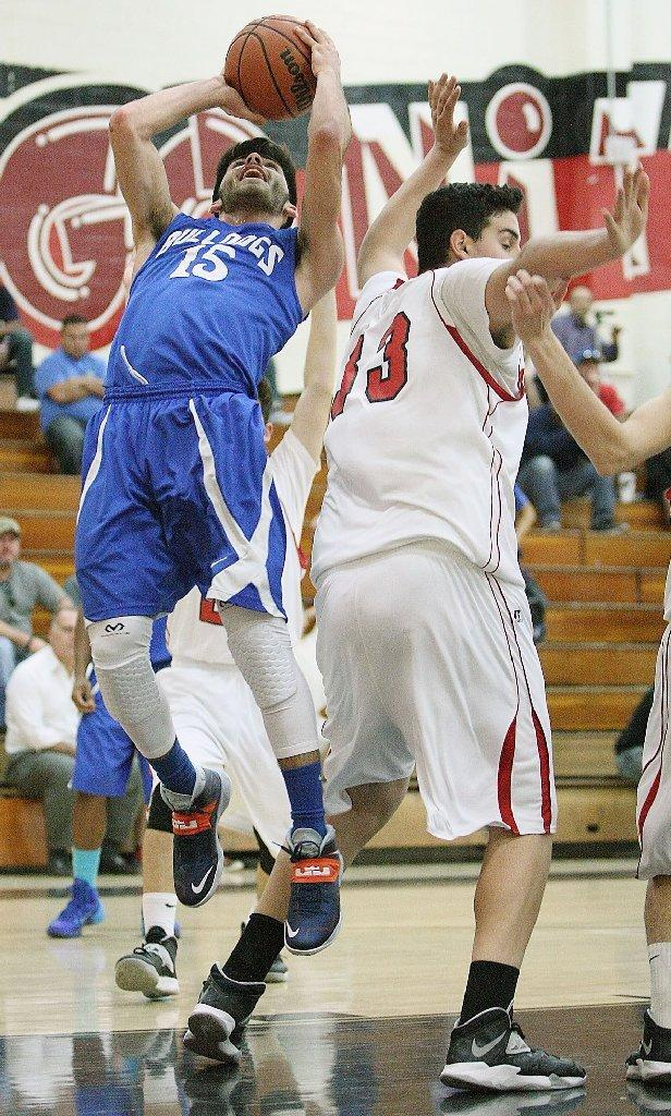 Burbank's Richard Elmoyan goes up for a shot attempt past Glendale's Arthur Terzyan during a game at Glendale High on Tuesday. (Roger Wilson/Staff Photographer)