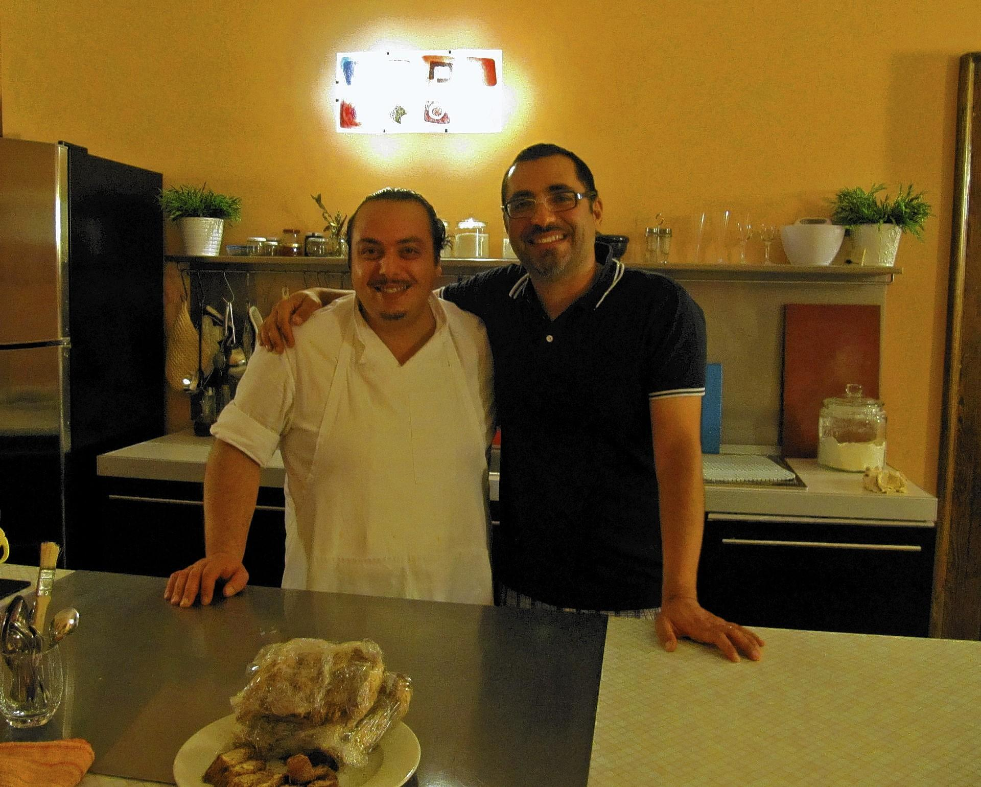 Chef Dino Paganelli (left) and Massimo Criscio, a sommelier and owner of a palazzo and cooking school in Italy, will prepare dinners at Molinari's Restaurant in Bethlehem on Jan. 27 and 28.