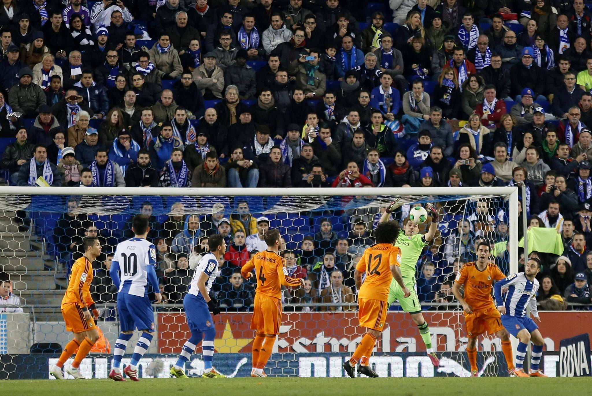 Real Madrid's Iker Casillas catches the ball against Espanyol players during their King's Cup soccer match at Cornella El Prat stadium, in Barcelona January 21, 2014.