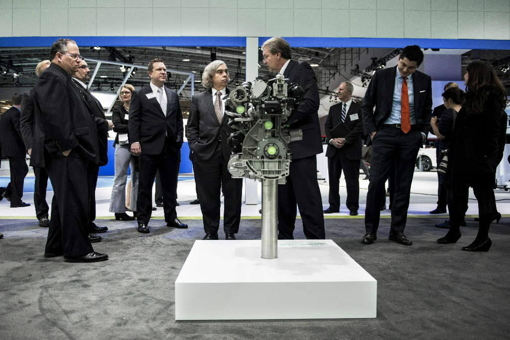 US Secretary of Energy Ernest Moniz(CenterL) tours Ford products at the Washington Auto Show at the Washington Convention Center January 22, 2014 in Washington, DC.