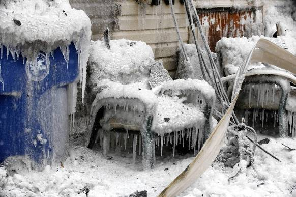 Iced-encrusted household items at the scene of a fire in Cicero.