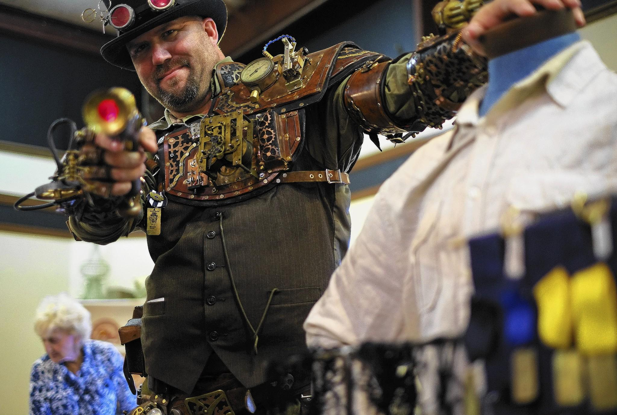 "RJ Foster attends the Steampunk gathering at the Renninger's Antique Center on Sunday, August 4, 2013 in Mount Dora. ""Captain Nemo, 20,000 Leagues Under The Sea,"" said Foster when describing Steampunk."