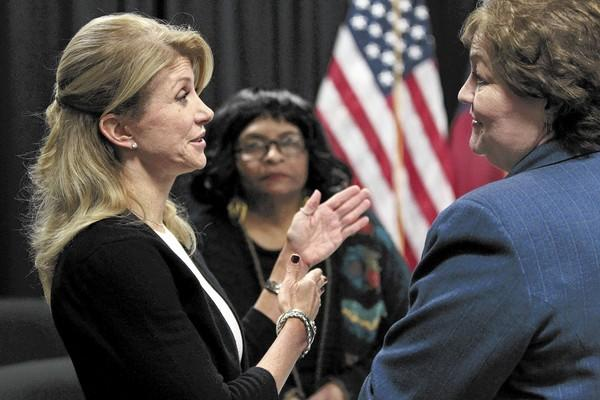 Texas state Sen. Wendy Davis (left), a candidate for Texas governor, talks with Shirley Mukendi and Rena Honea after an education roundtable in Arlington, Texas, on Jan. 9, 2014.