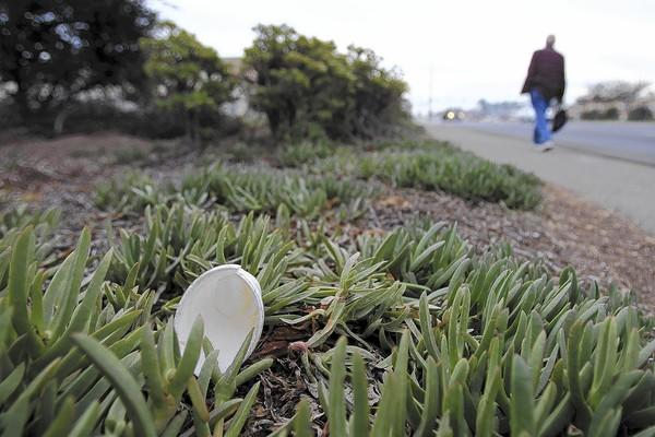A small Styrofoam cup is discarded along Beach Boulevard, just south of Slater Avenue, in Huntington Beach on Tuesday.