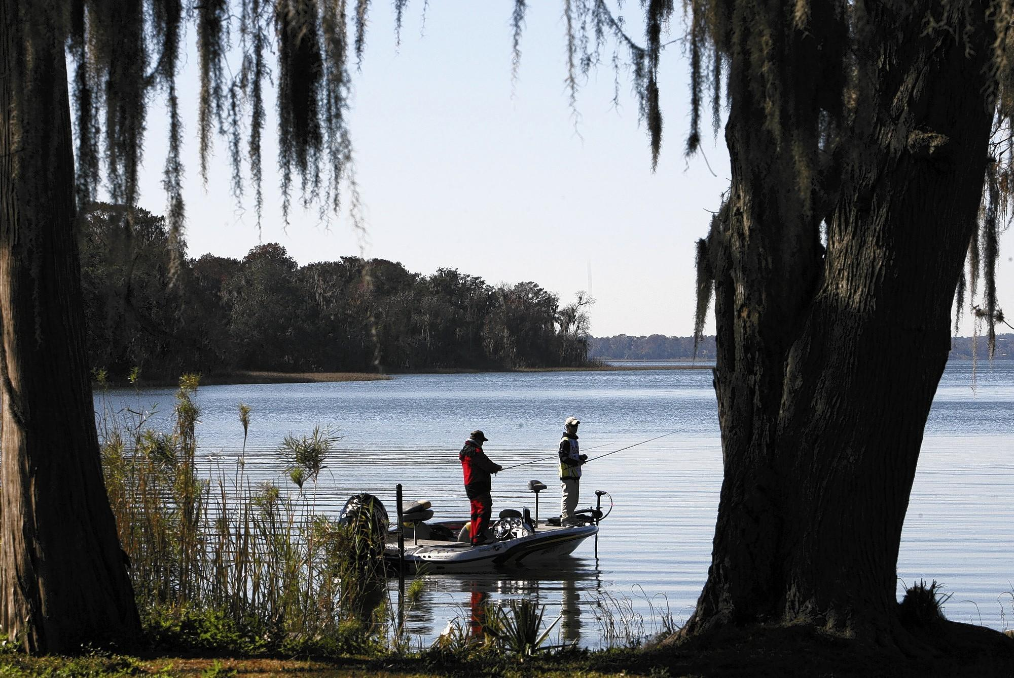 Anglers fish the banks of Lake Harris on Thursday, January 19, 2012.