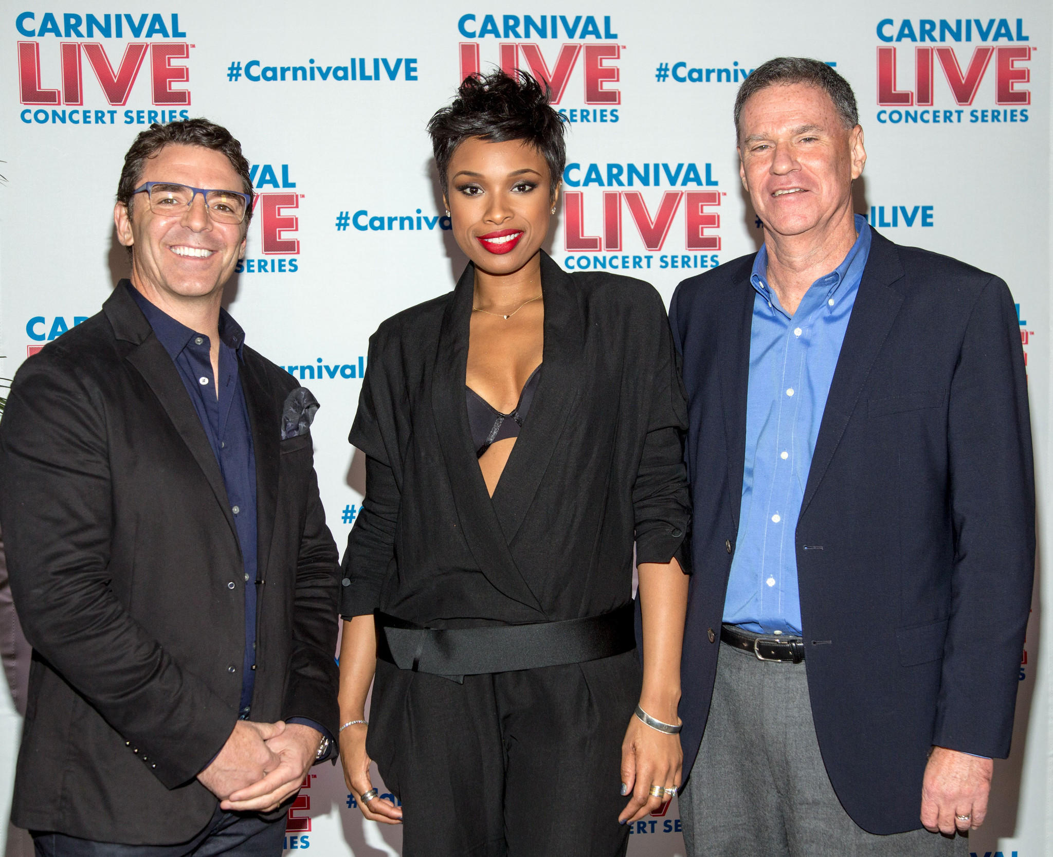 In this photo provided by Carnival Cruise Lines, Jennifer Hudson, GRAMMY Award-winning recording artist, joins Gerry Cahill, President and CEO of Carnival Cruise Lines, and Mark Tamis, Senior Vice President, Guest Operations of Carnival Cruise Lines, to announce Carnival LIVE, a new onboard concert series Jan. 22, 2014 in New York. Hudson, who gave a special surprise performance at the event, will entertain Carnival guests as part of the series which also includes other popular pop, classic rock and country artists.