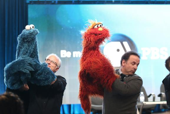 "Actor-puppeteer David Rudman, left, and actor-puppeteer Joey Mazzrino during the ""PBS Kids Update/Sesame Street 45th Season Anniversary"" panel discussion."