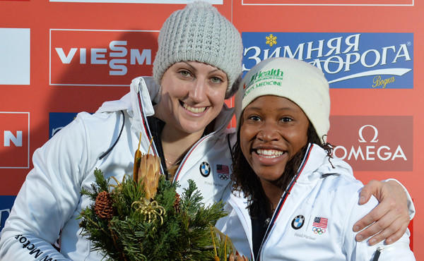 Lauryn Williams, right, and Jamie Greubel celebrate on the podium after winning a World Cup bobsled race in Innsbruck, Austria, on Sunday. Williams is set to become one of only a handful of U.S. athletes to compete in both the Summer and Winter Olympic Games.