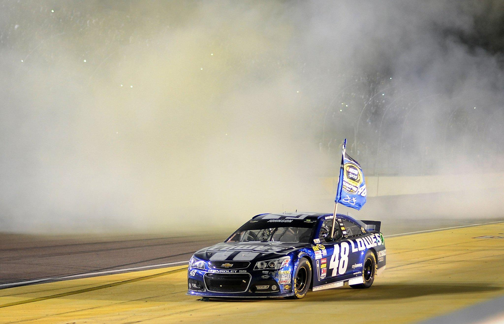 Jimmie Johnson wins the Sprint Cup Championship title after competing in the Ford EcoBoost 400 in Homestead, Fla.