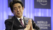 Japan's Abe uses Davos economic forum to warn of China militancy