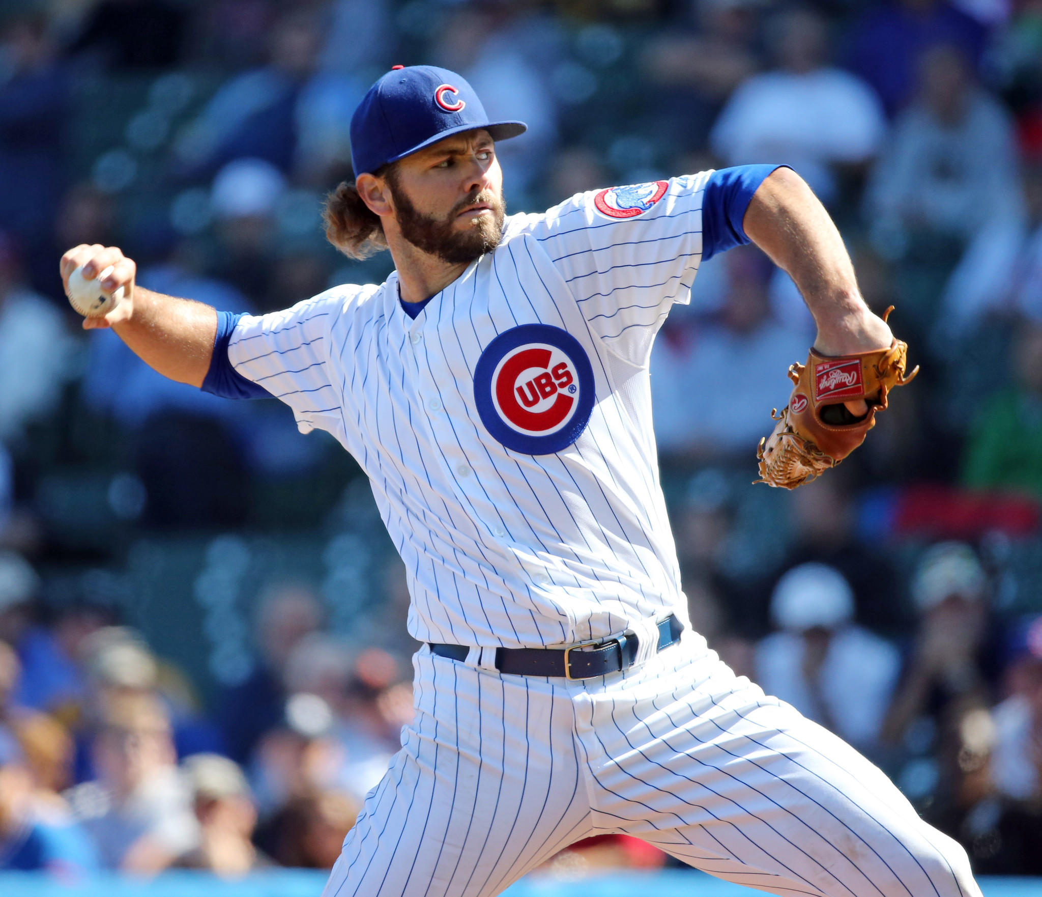 Cubs pitcher Jake Arrieta delivers to the Pirates in the first inning on Sept. 25, 2013.