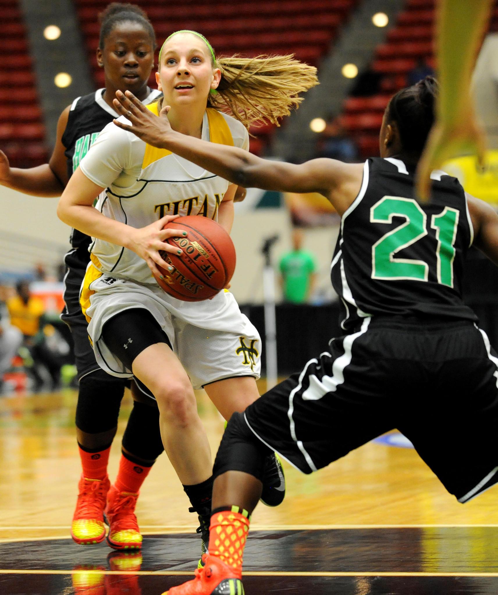 Bernadette Devaney of Nova High goes up for a shot as Jone' Akins (21) defends on the play. 2012-13 FHSAA Girls Basketball Championships Class 7A semifinal. Nova High vs. Haines City High. 2/22/13. Jim Rassol, Sun Sentinel.